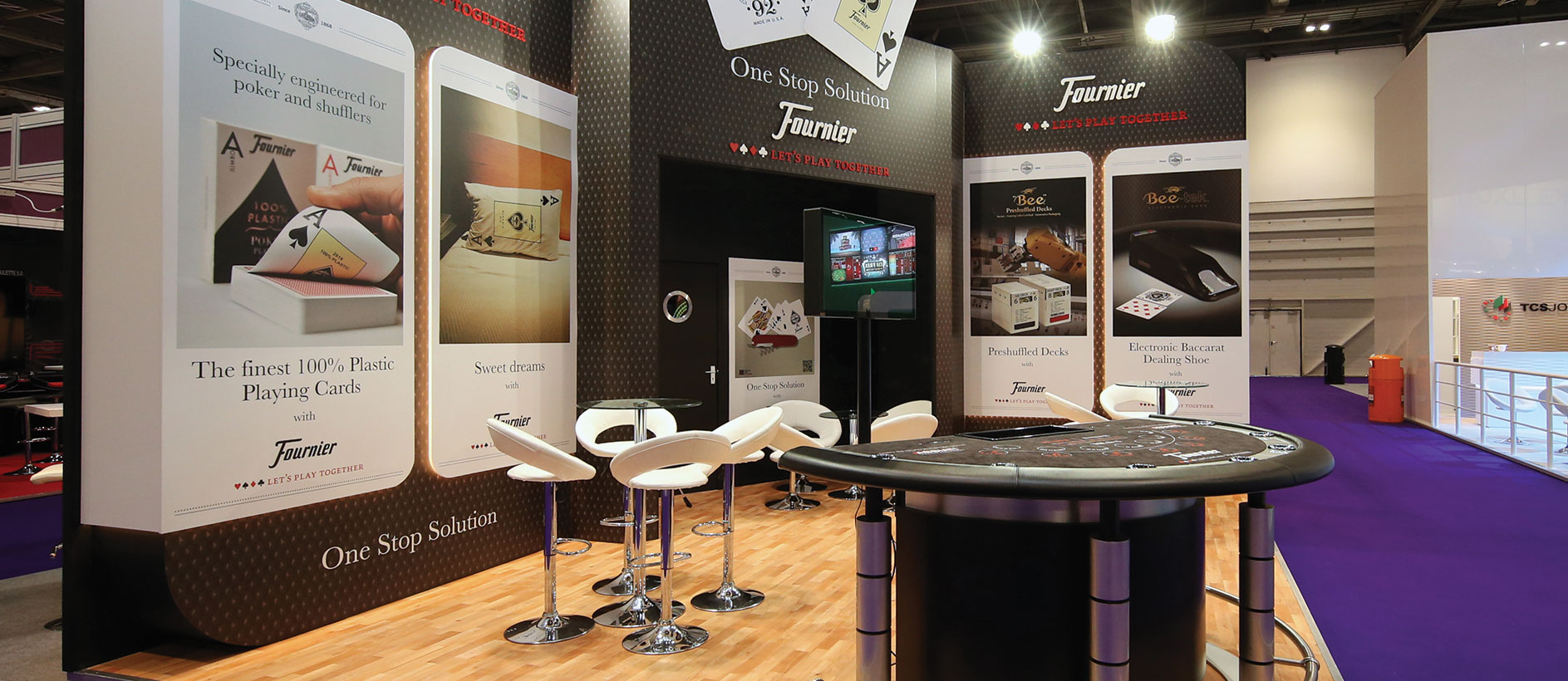 Bespoke stand by Exhibit 3Sixty with logos, furniture and graphics