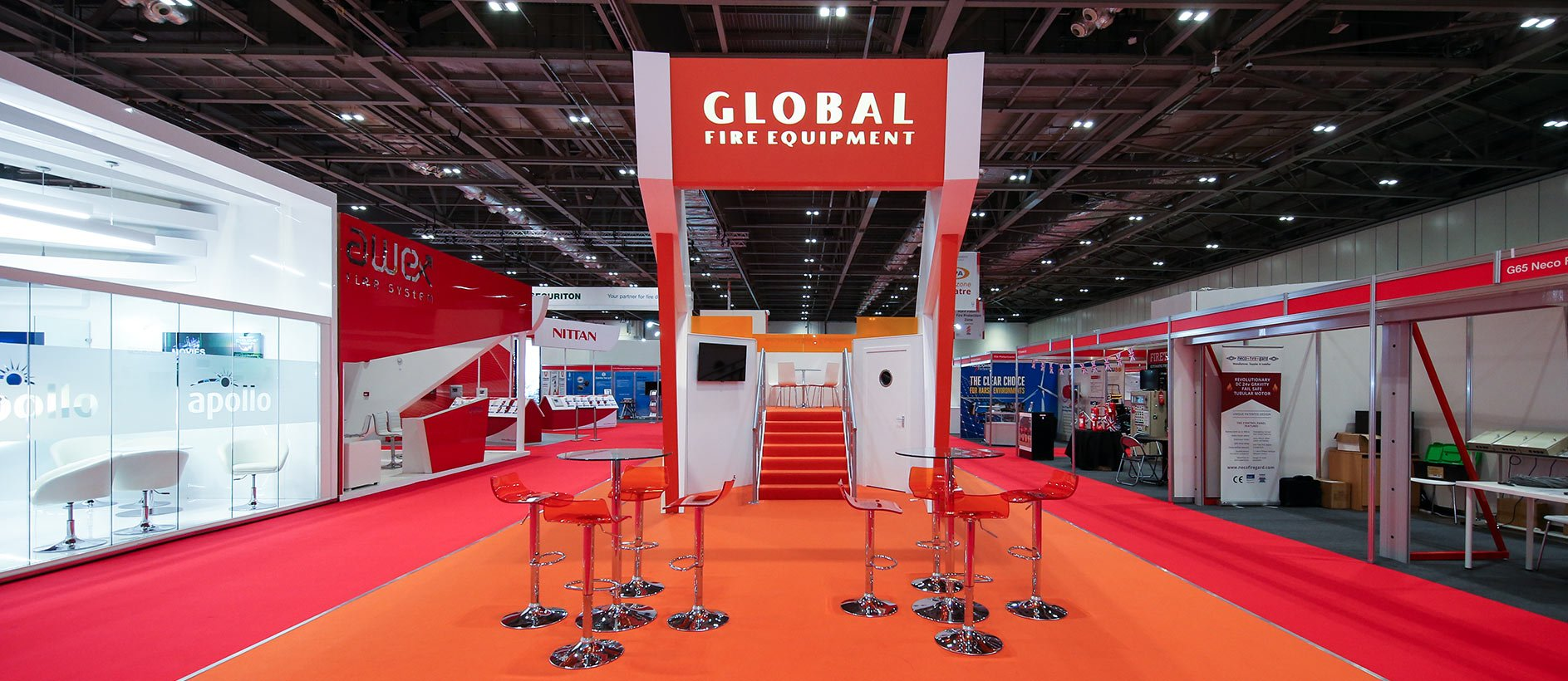 Exhibition stand design with custom furniture and flooring