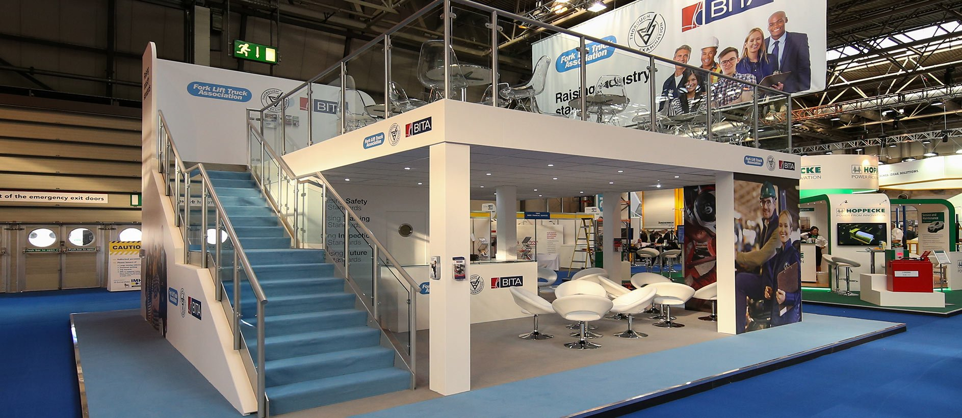 Exhibition stand display with furniture and graphics