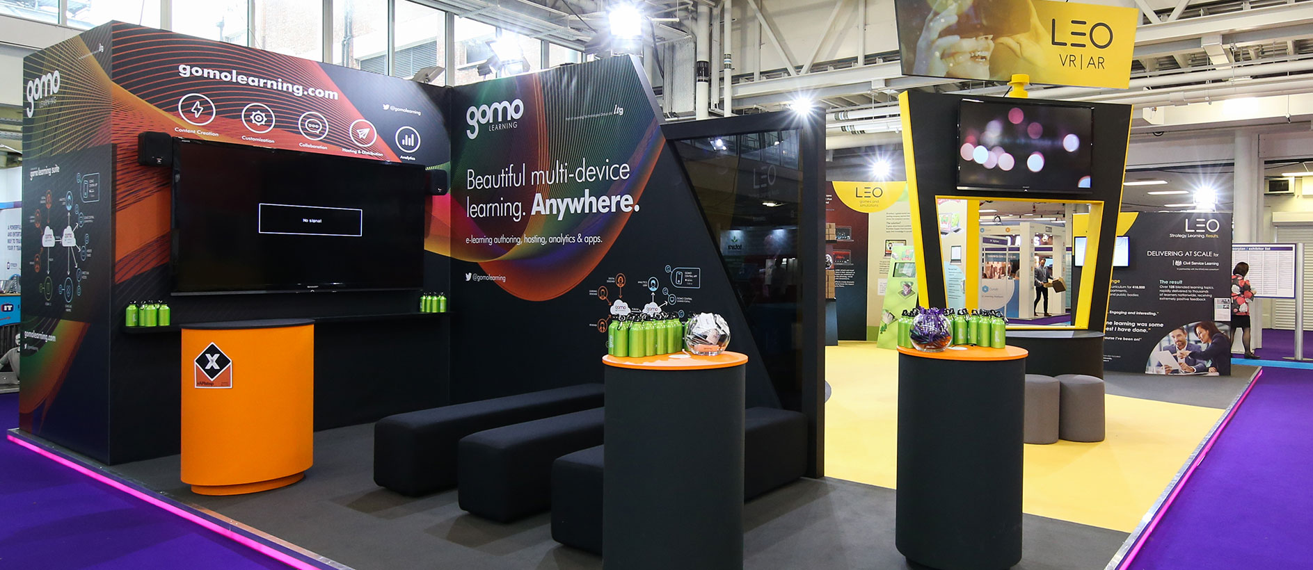 Custom exhibition stand with a seating area